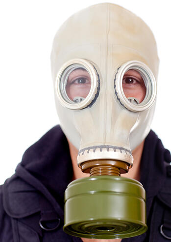 Man wearing a gas mask on his face - isolated over a white background